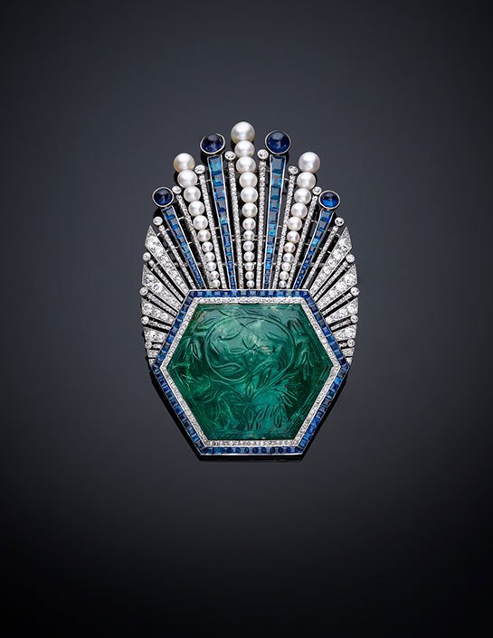 Brooch  1910  Paris; designed by Paul Iribe and made by Robert Linzeler; Colombian emerald carved in India  diamonds  pearls and sapphires set in platinum © The Al Thani Collection