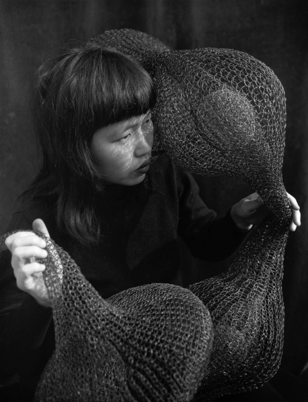 Ruth-asawa-holding-a-form-within-form-sculpture-1952