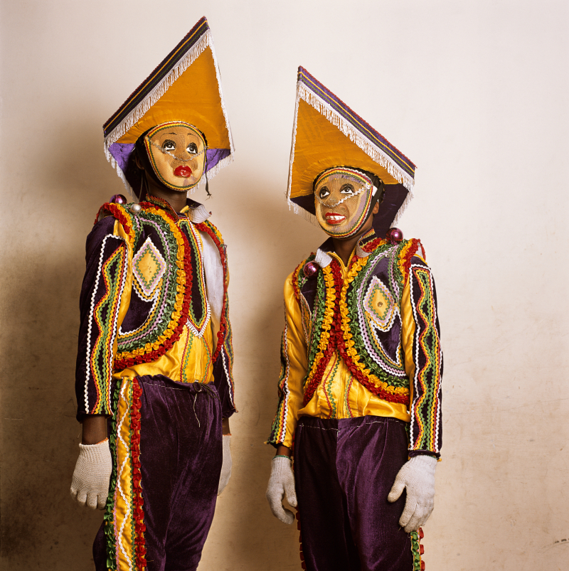 Phyllis Galembo  Two in Fancy Dress with Pointed Hats  Tumus Masquerade Group  Winneba  Ghana 2010